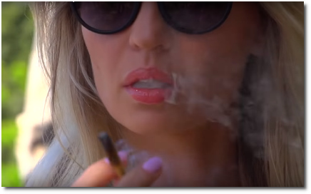 Girl smoking a joint that she rolled herself