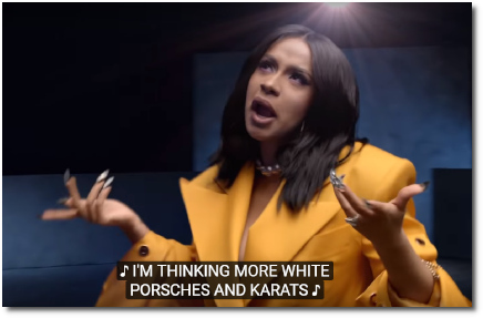 Cardi B thinking more white Porsches and karats in Girls Like You (30 May 2018)