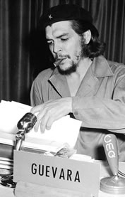 Che Guevara sitting at a microphone