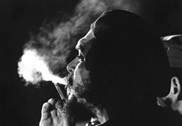Che Guevara smoking a cigar at night