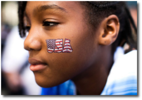 USA sticker on a brown-skinned face
