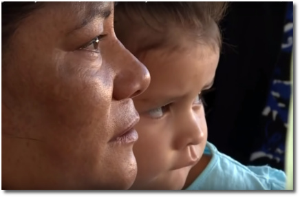 3-year old Sophie with her grandmother at the border in Juarez
