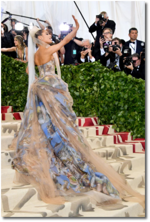 Ariana at the Met Gala wearing a dress with imagery from Michelangelo's The Last Judgment (7 May 2018)